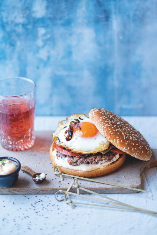 Hamburger with onion and fried egg